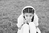 Technology Can Be Your Best Friend. Small Child Enjoying Stereo Sound Technology On Green Grass. Lit poster
