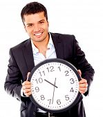 Business man holding a clock - isolated over a white background