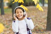 Best Song About Fall. Cute Small Child Enjoy Song Playing In Headphones. Adorable Little Girl Sing A poster
