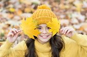 Cute Smile Of Autumn. Happy Girl Play With Yellow Leaves. Little Child Smile On Autumn Day. Healthy  poster