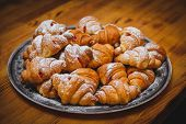 Big Plate With A Lot Of Delicious Freshly Cooked Croissants. Powdered Sugar On Top Of Croissants. Ph poster