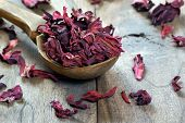 Dry Hibiscus In A Wooden Spoon. Dried Hibiscus Petals On A Wooden Table. Hibiscus Tea.  Vitamin Tea  poster