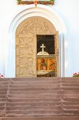 Brown Steps Leading To The Entrance To The Orthodox Church. Bronze Entrance Doors Of An Orthodox Whi poster