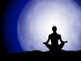 stock photo of moon silhouette  - Person meditating in front of the full moon - JPG