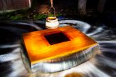 image of shadoof  - Old flooding well and a sweep or shadoof with timber bucket at golden sunlight - JPG