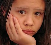 Sadness In Young Girl Close Up