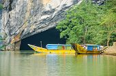 Tourist boats, the mouth of Phong Nha cave with underground river, Phong Nha-K? B�?� ng National Park, Vietnam
