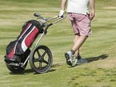 Golfer Walking On Course With Bag