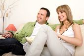 Smiling Couple Watching Tv