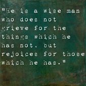 Inspirational quote by Epictetus on earthy green background