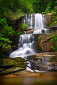 stock photo of backwoods  - Motion Blur Waterfalls Nature Landscape in Blue Ridge Mountains with green trees rusty natural orange rocks and flowing water - JPG