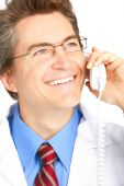 foto of medical doctors  - Smiling medical doctor calling by phone - JPG