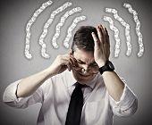 Business man having a headache and Stress