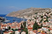 SYMI, GREECE - JUNE 17: Looking down onto Yialos town and harbour on June 17, 2011 on the Greek isla