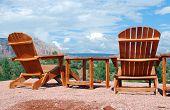 Wooden Adirondack chairs overlooking scenic Sedona