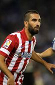 BARCELONA - OCT, 19: Arda Turan of Atletico de Madrid in action during a Spanish League match against RCD Espanyol at the Estadi Cornella on October 19, 2013 in Barcelona, Spain