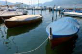 Covered Boats Moored In The Marina At Iseo, Lombardy, Italy