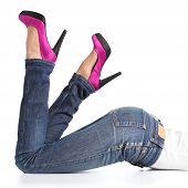 Beautiful Woman Legs With Jeans And Fuchsia High Heels Lying Down