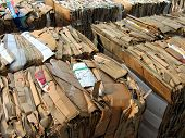 stock photo of recycled paper  - cubes of packed corrugated paper and newspaper ready to recycle - JPG