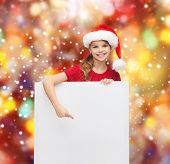 christmas, x-mas, people, advertisement, sale concept - happy woman in santa helper hat with blank w