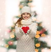 seasonal, people, happiness , health, charity, love concept - smiling teenage girl in winter clothes