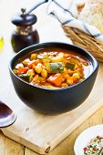 foto of chickpea  - Vegetables soup with chickpea by bread loaf - JPG