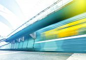 stock photo of passenger train  - Perspective wide angle view of modern light blue illuminated and spacious public metro marble station with fast blurred trail of vivid yellow train in vanishing traffic motion - JPG