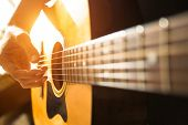 stock photo of guitar  - Female hand close - JPG