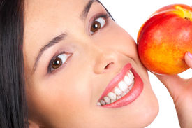stock photo of beautiful young woman  - Beautiful young woman with a peach - JPG