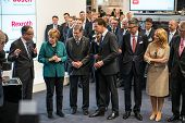 HANOVER, GERMANY - APRIL 7: German Chancellor Angela Merkel during a technology showcase tour of industrial Robotics by Bosch and Rexroth at the Hannover Messe 2014