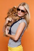 Summertime. Attractive girl with dog