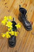 Black Military Muddy Shoes With Yellow Narcissus