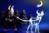Santa claus looking at magic image of deer