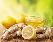 picture of ginger  - Ginger tea with lemon on a wooden table - JPG