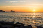 stock photo of costa blanca  - Sunrise on Altea bay facing Calpe Costa Blanca Spain - JPG