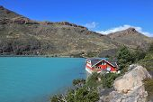 National Park Chile - Torres del Paine. Island Lake Pehoe and comfortable hotel