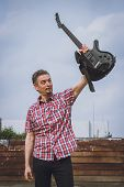 Man In Short Sleeve Shirt Holding Electric Guitar