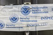 LOS ANGELES, CALIFORNIA - MARCH 24: Suitcase sealed with Transportation Security Administration inspected notification tape.