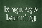Education concept: Language Learning on chalkboard background