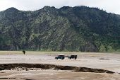 foto of bromo  - Two 4wd cars in caldera of volcano Bromo in OIndonesia - JPG