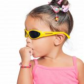 Multiracial small girl  wearing bright  yellow sunglasses isolated on white