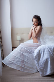 image of underskirt  - Image of sexy young woman posing in wedding underskirt - JPG