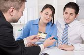 Young couple in a meeting - insurance or bank