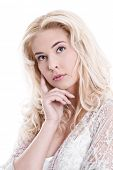 Portrait of  young pretty blond woman thinking on white background