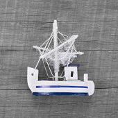 Fishing boat decoration on the wooden background