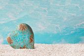 A lone heart in turquoise on the beach - decoration maritime