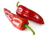 two red sweet peppers on white