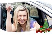 Charming female driver showing a key after bying a new car against snowflake frame