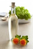Bottle with Safflower oil on white background