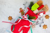 Christmas gift wrapping idea  with oven mitt,kitchen utensils and cookies